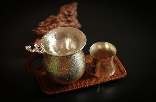 Lọc trà hoa mai bằng Bạc